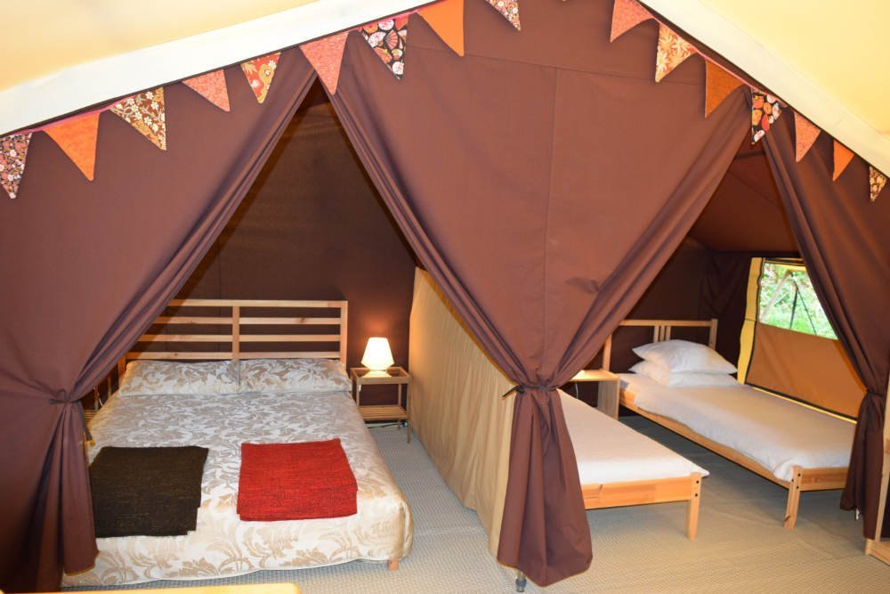 Double and 2 single beds in lodge tent